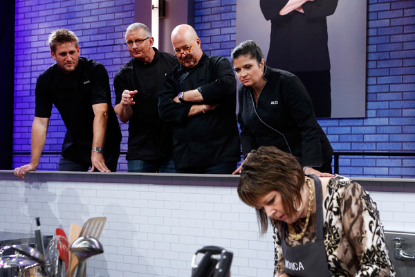 Mentors Curtis Stone, Robert Irvine, Andrew Zimmern and Alex Guarnaschelli observe contestant Monica Folken on Food Network's `All-Star Academy.` (Submitted photo)