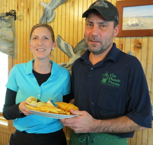 The Beach House's Dawn Heitman and Shawn Vaine hold the restaurant's award-winning beer-battered fish fry.