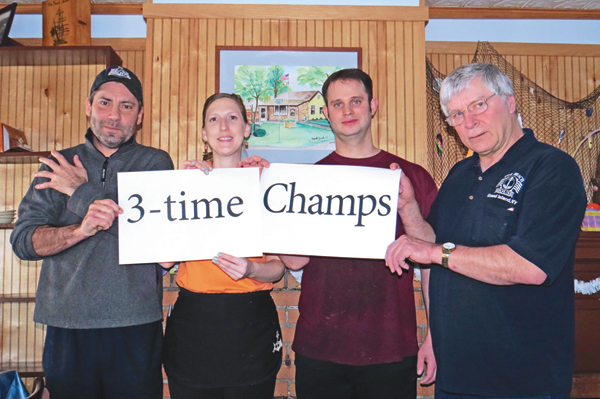 `Team Beach House` holds a `3-time Champs` sign. Pictured, from left, are Shawn Vaine, Dawn Heitman, Christian Westmoore and Mike Mongan. Click for a larger image.