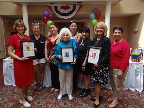 Winners of the `Cutest Cupcake` contest held recently at Amberleigh Retirement community stand with the judges. First place went to Karin Kunecki, second place to resident Margot Hamilton, and third place to Executive Director Margaret Kleinmann. All proceeds from the cupcakes sold at the event went to the WNY Chapter of the Alzheimer's Association.