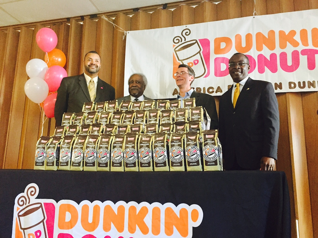 Dunkin' Donuts announced a donation of $5,000 in coffee to the Buffalo Division of Senior Services at the Richmond-Summer Senior Center. The donation will be distributed to senior centers throughout the city. Dunkin' Donuts also announced a 10 percent discount to City of Buffalo employees using a special Dunkin' Donuts card at participating Dunkin' Donuts locations through April 2015. Pictured, from left, are City of Buffalo Deputy Commissioner Otis Barker; City of Buffalo Director of Senior Services Doug Ruffin; Dunkin' Donuts Franchisee Doug Spolyar; and Buffalo City Mayor Byron Brown.