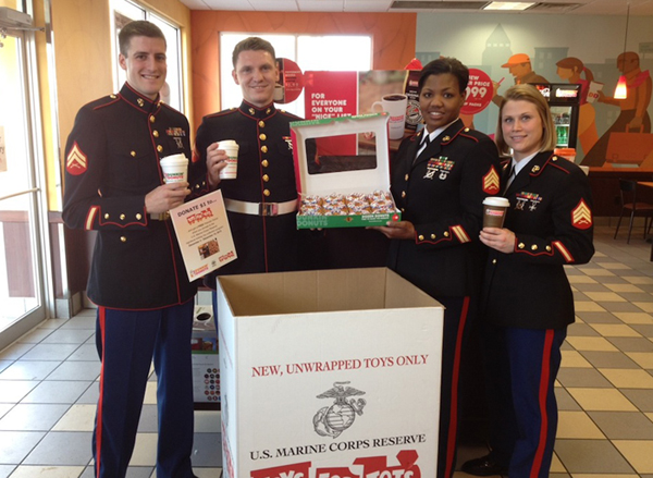 U.S. Marines surprised Dunkin' Donuts guests by filling orders and handing out prizes at the drive-thru window and register at the Dunkin' Donuts at 3155 Delaware Ave., Kenmore, on Wednesday. The event served as the kick-off for the Toys for Tots program in Western New York.