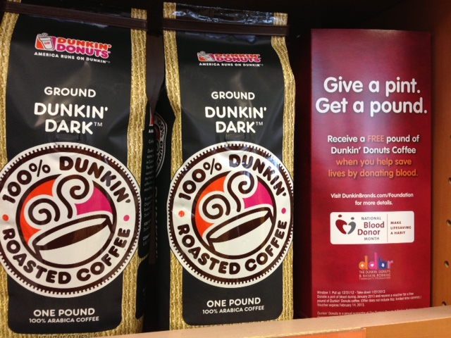 A sign promoting the annual `Give a Pint, Get a Pound` campaign is positioned alongside packages of coffee at the Dunkin' Donuts at 2200 Sheridan Drive in Tonawanda on Thursday, Jan. 3.