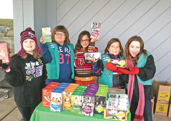 From left, Jordan Rowland, Samantha Meyers, Kaia Foster, Tori Smith and Jamie Drury of Cadette Girl Scout Troop No. 70091 sell cookies.