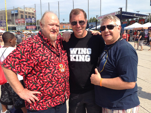 Pictured, from left, sauce judges George Booth III (left) and Heath Mazenauer (Niagara Frontier Publications general manager) flank National Chicken Wing Festival `Wing King` Drew Cerza.