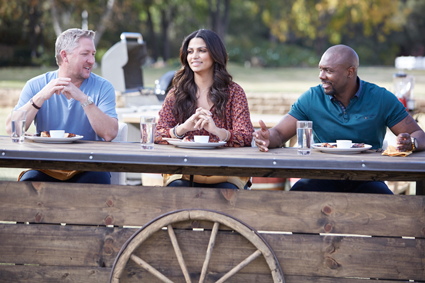 "Guest judge Tim Love with hosts Camila Alves and Eddie Jackson on Food Network's ""Kids BBQ Championship."" (Food Network photo)"