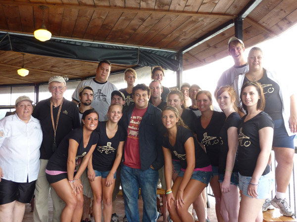 `Man v. Food` host Adam Richman poses with Alan Hastings (second photo) and with workers at The Silo Restaurant in Lewiston. While on location, his television crew filmed the area for an episode set to air in September. `It's great for Lewiston; it's great for us; and it's great for the employees,` Hastings said.