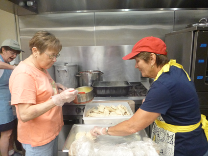Laura Stockburger and Judy Smolka prepare pierogi at the kitchen at the Our Lady of Czestochowa parish hall in North Tonawanda.