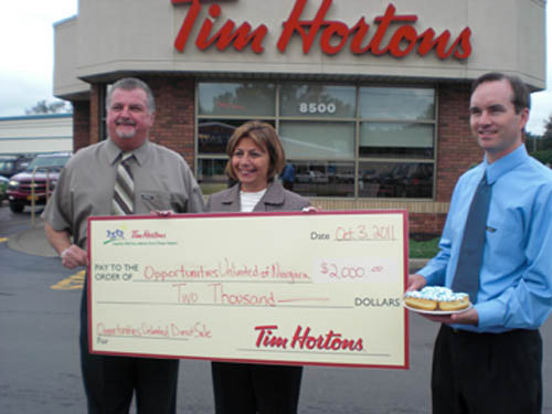 Pictured are: Bob Burns, restaurant owner with Tim Hortons Cafe & Bake Shop; Connie S. Brown, executive director of Opportunities Unlimited of Niagara; and Jon Maurer, regional marketing manager of Tim Hortons Cafe & Bake Shop.