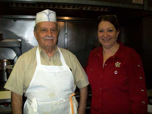 Debbie Spencer of Pete's Market House poses with chef Jimmy Vlahopoulos.
