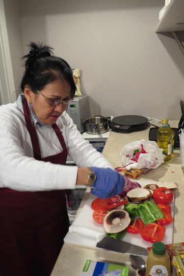 "Piat Phuah works on her ""Italian wrap."""