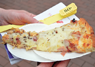 Shown is a slice of TC Wheelers Reuben pizza. The specialty pizza will be offered at Pizza Fest and was voted