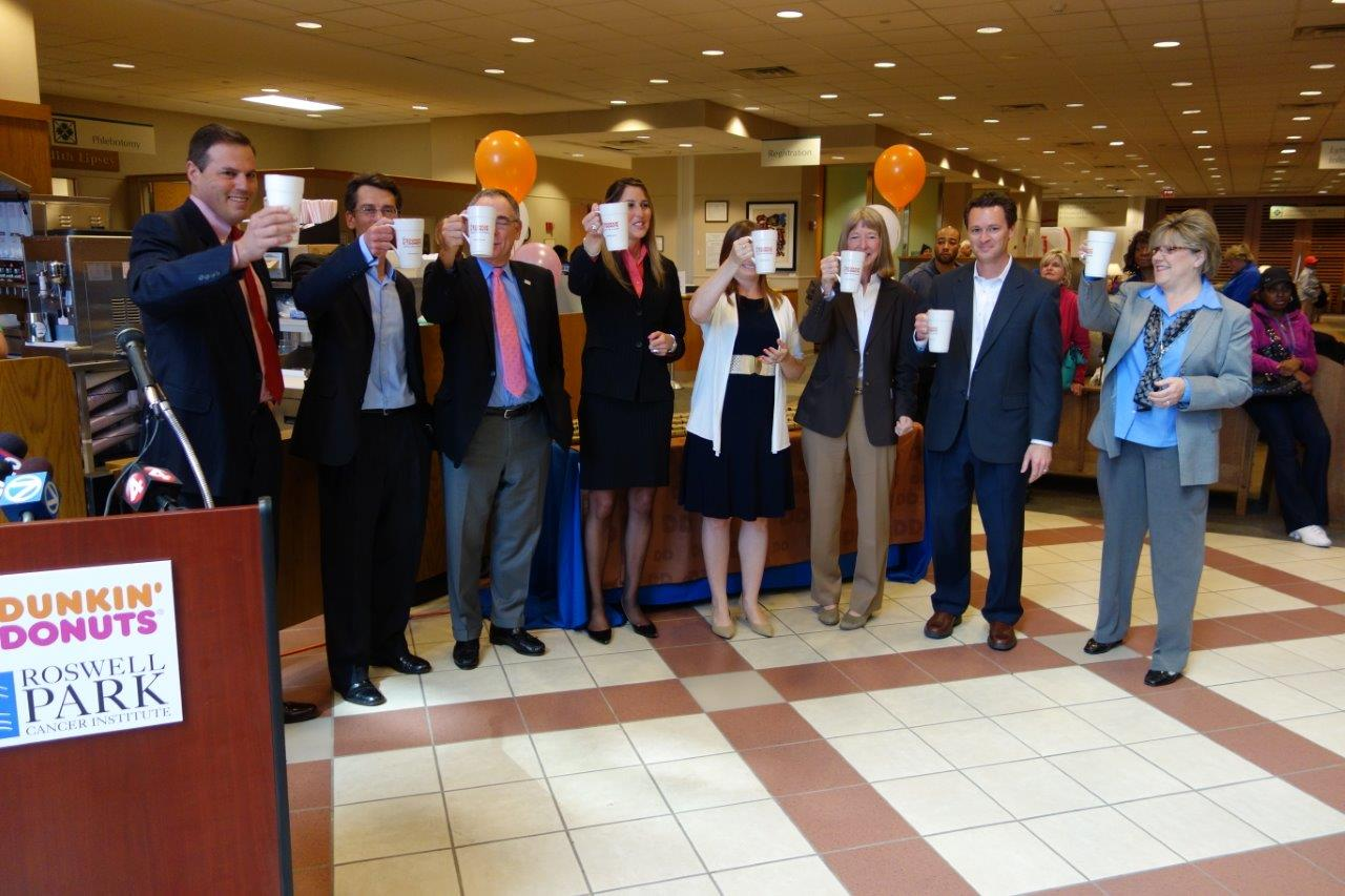 Dunkin' Donuts Franchisee Tim Cloe (far left) toasts the team at Roswell Park Cancer Institute at the grand opening of the Dunkin' Donuts restaurant at RPCI on Tuesday, May 14.