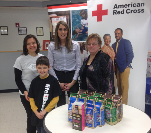 Dunkin' Donuts and the American Red Cross launched the seventh annual `Give a Pint, Get a Pound` campaign in Buffalo at the American Red Cross Donation Center at 786 Delaware Ave. Pictured, from left, is Gina Bellavia, mother of a blood recipient; Theo Bellavia, blood recipient; Alisa LaPlante, Dunkin' Donuts field marketing manager; and Kay Schwartz, CEO of American Red Cross - New York-Penn region, at the `Give a Pint, Get a Pound` kickoff event.