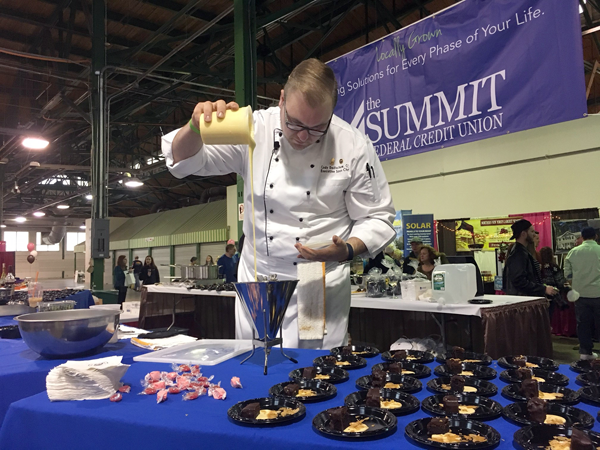 Chef Cody Dedischew prepares a chocolate torte tasting at The Summit Federal Credit Union Wine and Chocolate Festival in Syracuse last month.
