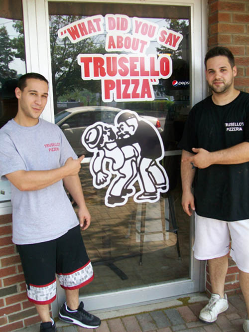 Brothers Joey and Anthony Trusello stand outside of their new business, Trusello's Pizzeria, at 742 Center St., Lewiston.