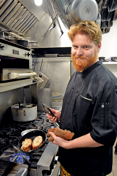 Executive Chef Jeremy VanAntwerp prepares pork loin roulade, a dish planned to be offered at Webster's Kitchen.