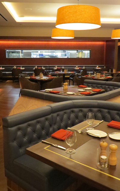 The dining room is more open and contemporary but still with its peak-in kitchen windows where both chefs and seafood selections are on display. & Revamped Western Door Steakhouse opens bistro debuts at Seneca Niagara