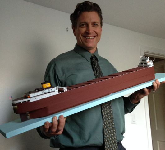 Thomas Paul Asklar displays a model of the Edmund Fitzgerald.