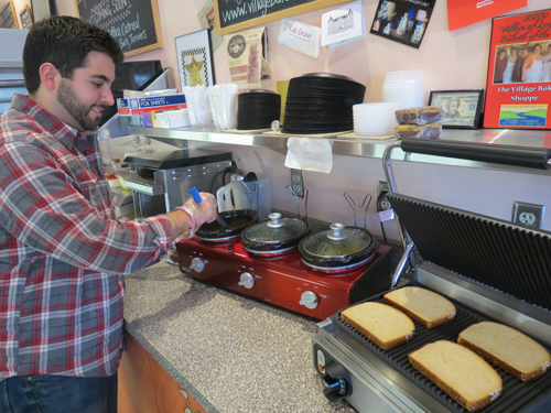 Mike Fiore readies the soup and panini stations at the Village Bake Shoppe.