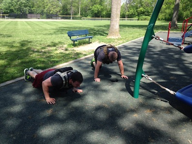 Brandon Hall and Alex Ruckh do push-ups during the MDM at Kiwanis Park.