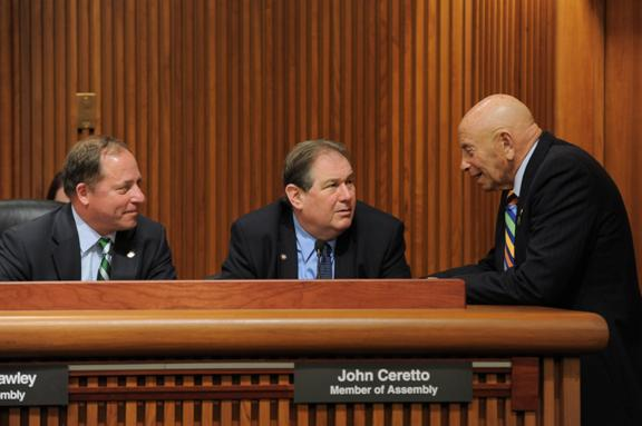 Assemblyman John Ceretto discusses services for the developmentally disabled with Assemblymen Steve Hawley and Harvey Weisenberg at the State Legislature's Mental Hygiene Budget Conference Committee.