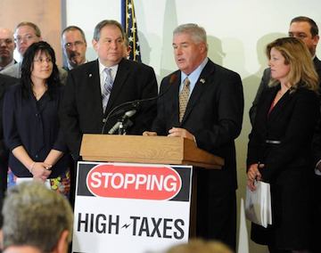 Assemblyman John Ceretto stands next to Assembly Minority Leader Brian Kolb at a press conference to oppose the extension of the utility tax on families, businesses and energy providers.