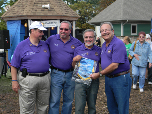 Honoree Dr. Jerry Mosey (second from right) is shown in his role as Kiwanis Club of Lewiston 2012 president, at last year's Niagara County Peach Festival. Joining Mosey at the event (left to right) were Albert Norato Jr., Kiwanis New York district governor 2012-13; Ron Parent, Lewiston Kiwanis member and district lieutenant governor 2010-11; and Kiwanis International President 2012-13 Tom DeJulio. (photo by Terry Duffy)