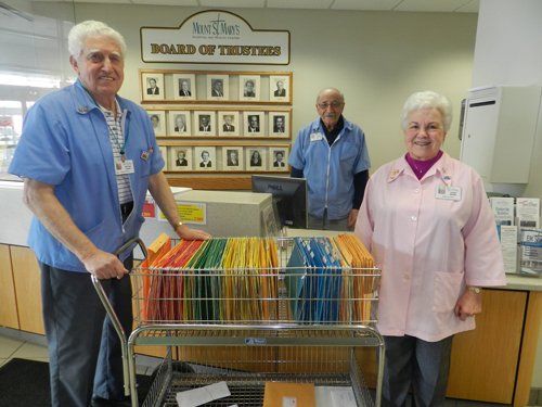 More than 60 Town of Lewiston residents serve as volunteers, performing a variety of important functions, at Mount St. Mary's Hospital and Health Center. From left: Peter Sirianni, mail cart; Steve LaBarber, information desk/patient information; and Joan Sirianni, surgery waiting room hostess.