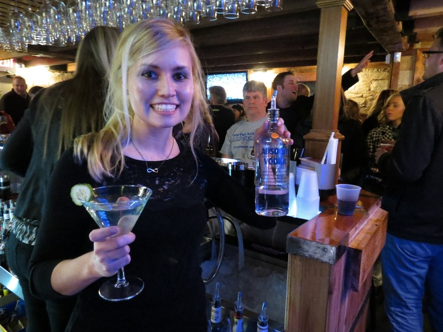 Christina Crane was busy Saturday night serving Lewiston Cocktail Festival participants at the Stone House on Center Street.