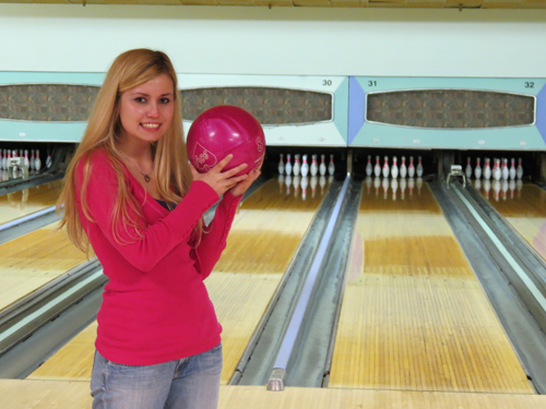 Christina Crane holds a new, `hot pink` bowling ball at the Lewiston Event Center. The site, formerly Frontier Lanes, will host the next `Business Blender.`