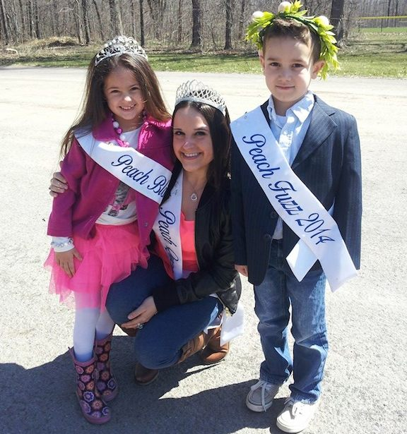 Peach Queen Ali Casale stands with Peach Blossom Alyssa Strangio and Peach Fuzz William Mollosky.