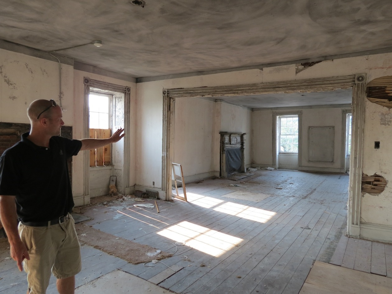 Alan Hastings points to the second floor Frontier House space he intends to convert into a banquet and band space. The building, located at 460 Center St., has sat vacant for almost a decade.