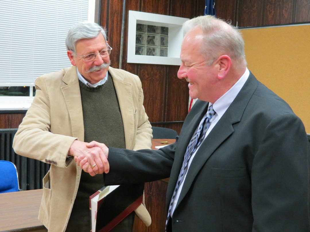 Village of Lewiston Mayor Terry Collesano, left, welcomes new Trustee Daniel R. Gibson to the board.