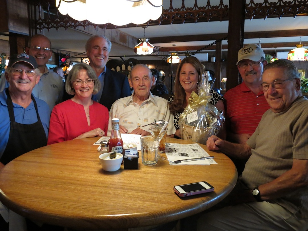 Pictured, from left, are John Roberts, owner of Apple Granny; Al Frosolone of Niagara's Choice Credit Union; HAL Executive Director Pam Hauth; HAL volunteer and place mat writer Lee Simonson; Jim Brown; HAL President Leandra Collesano; HAL volunteer Norm Machelor; and Bill Kresman.
