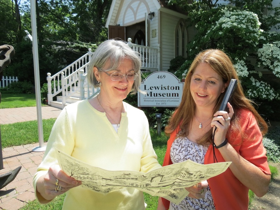 The Historical Association of Lewiston's Pam Hauth, left, and Leandra Collesano take advantage HAL's new walking map and audio tour wands. (photo by Joshua Maloni)