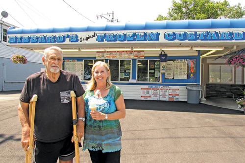 Jim Hibbard and Kris Trunzo stand in front of their family ice cream stand in Lewiston. Hibbard's' Original Frozen Custard is celebrating its 75th anniversary.