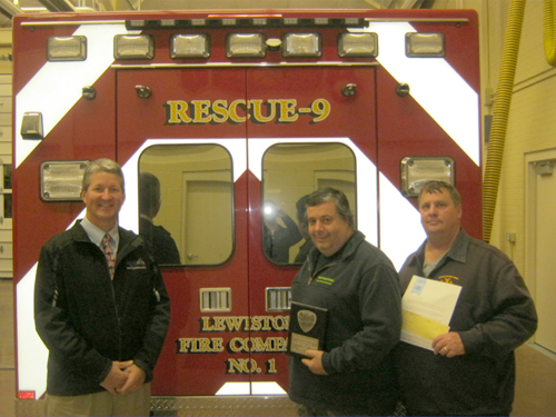 Mighty Niagara Half Marathon Race Chairman Paul Beatty presents a plaque to Chief John Penzotti and Les Myers, president of Lewiston Volunteer Fire Co. No. 1, to thank the fire company for providing services for the Niagara Hospice fundraiser.