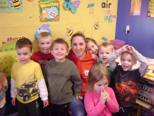Carla Fasso is pictured with some of her child care students.