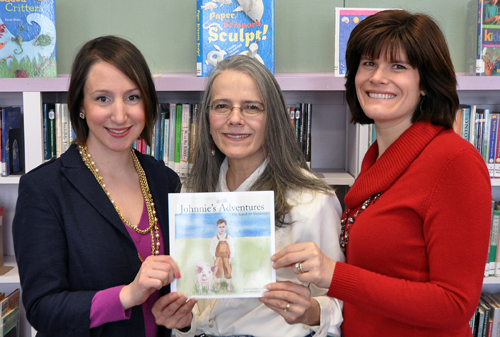 Illustrator Kristen Raimondi, author Suzanne Simon Dietz and publisher Amy Freiermuth hold a copy of `Johnnie's Adventures.` The three women will hold a book signing at Ashker's in Youngstown from 2 until 4 p.m. on Saturday, Feb. 2.