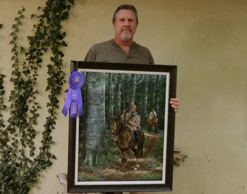 Artist Geoffrey Harding holds his 2012 Best of Show painting `The Way Before.`