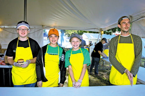 Lewiston-Porter Builders Club members work the food tent at last year's Peach Festival.