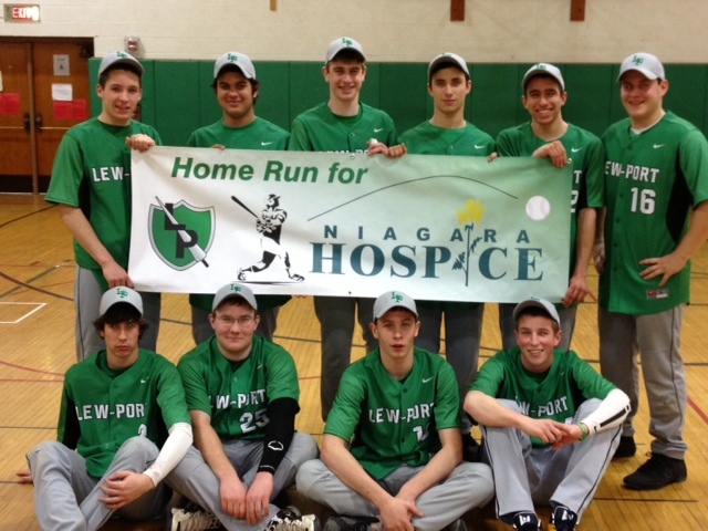 Lew-Port Varsity baseball players hold their new banner for the `Homerun For Hospice` tournament. Standing, from left: Joe Scirto, Matt Shiavi, Jake Rizzo, Mike Mokhiber and Antonio Guerucci; seated, from left: Zach Dowsey, Christian Snell, Justin Nichols and Jordan Willard.
