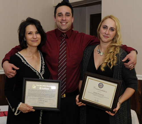The Lewiston No. 2 Volunteer Fire Co. paid tribute to the late Joseph Passanese Sr. at its 72nd installation of officers dinner. In the photo, from left, Passanese' wife Lynn, son Joe Jr., and daughter, Lauren Passanese-Campbell, are shown with a New York State Legislature citation presented by Assemblyman John Ceretto, and a U.S. House of Representatives commendation from Rep. Chris Collins. (photo by Kevin and Dawn Cobello, K&D Action Photo and Aerial Photography)