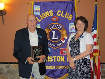 Pictured, from left, is Lion of the Year Bud Snell with new Lions Club President Regina Cecconi. (photo by Joshua Maloni)
