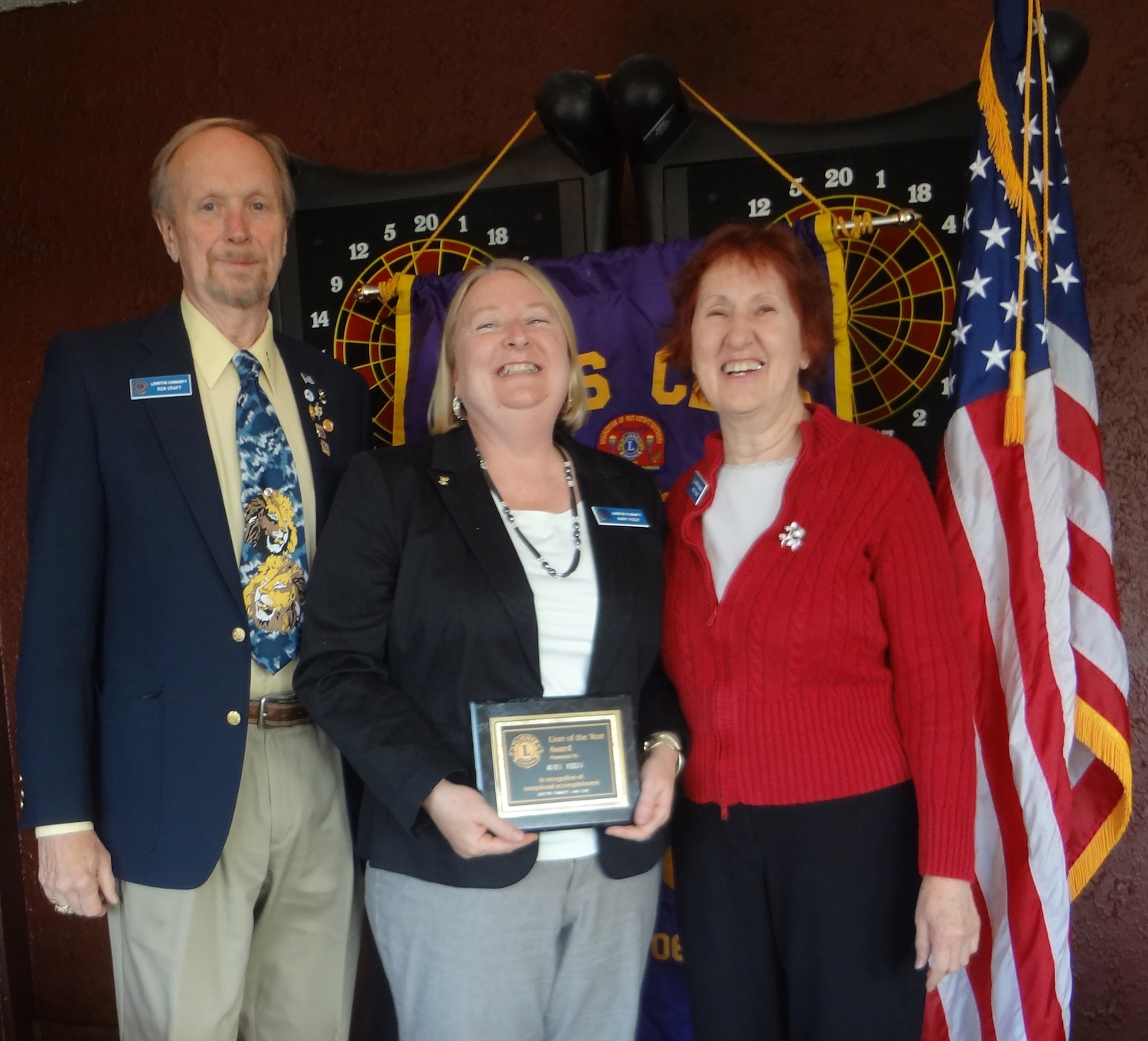 Lewiston Lions Club President-elect Ron Craft is pictured with Lion of the Year Mary Reedy and outgoing President Millie Gibbs.