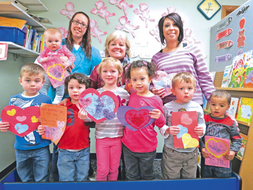 Pictured are some of the children who made Valentine's Day cards for Our Lady of Peace residents. In the second row, from left, are Mount St. Mary's Child Care Center staffers Dawn Smith, director Virginia Wolbert and Stephanie Cook.