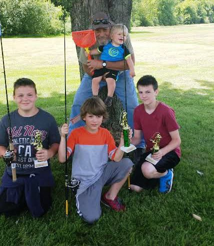 Ed Mort with grandson, Edward Lucas Mort, and his friends at the Wilson Fishing Derby.