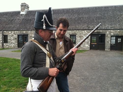 Old Fort Niagara re-enactor Guy Rizzuto, left, shows Mike Shubic a musket. (photo by Michelle Blackley)