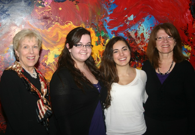 Dr. Nancy McGlen, Laura Brownlie, Gina DelGreco and Marian Granfield smile during the opening reception for `Chromatic Dynamism: Color and Motion,` an exhibition curated by Brownlie and DelGreco that is now on display at the Castellani Art Museum.